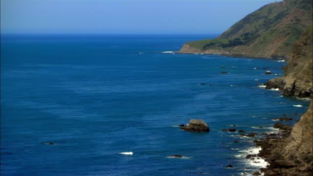 wide shot pan waves crashing on rocky coast/ san simeon, california, usa - ragged point stock videos and b-roll footage