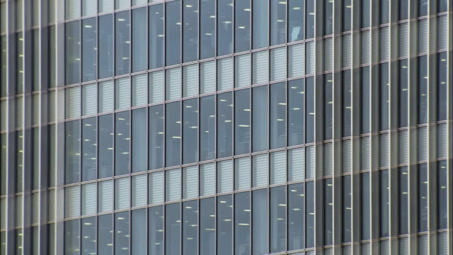 wide shot pan windows and detail of office building/ london - two dimensional shape stock videos and b-roll footage