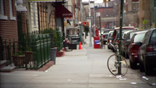 wide shot pan woman walking down city street / williamsburg, brooklyn, new york, usa - pavement stock videos & royalty-free footage