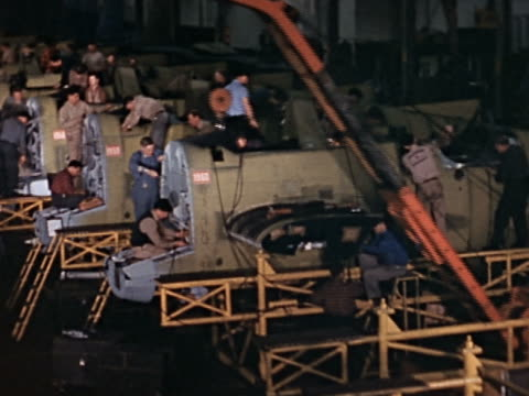 wide shot pan workers manufacturing military airplanes on factory floor - world war ii stock videos & royalty-free footage