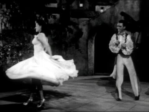 1944 Wide shot pan Yvonne De Carlo dancing with Latin man/ AUDIO