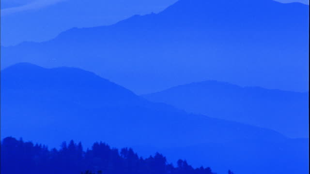 wide shot pan zoom out angeles crest forest and mountains at dusk / california - angeles national forest stock videos and b-roll footage