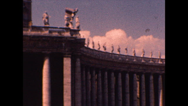 wide shot panning right of colonnades that surround the piazza. wide shot panning right of people ascending steps to the basilica in 1952. from the... - fountain stock videos & royalty-free footage