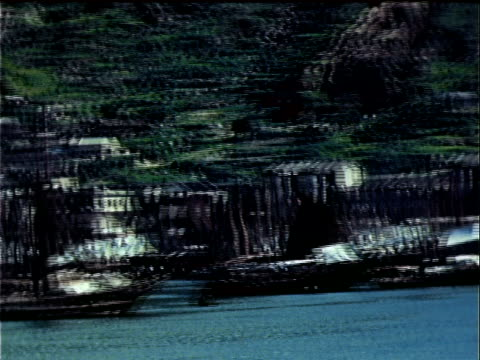 1939 wide shot panning waterfront/ hong kong - 1939 stock videos and b-roll footage