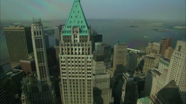 wide shot pan-right tilt-up - a cornea of light shines above the trump building. / new york city, new york, usa - cornea stock videos & royalty-free footage