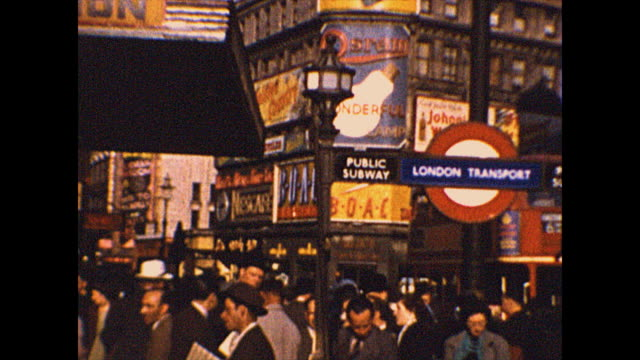 wide shot pans left of the famous piccadilly circus in london in 1952. it is a colorful scene with building facades that are decorated with ads. from... - colour image stock videos & royalty-free footage