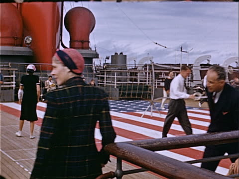 1939 wide shot passengers playing frisbee on deck of vintage steamship during cruise / usa  - cruise collection stock videos & royalty-free footage
