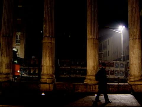 vidéos et rushes de wide shot pedestrians walking along street at tram passes by / milan, italy - ligne de tramway