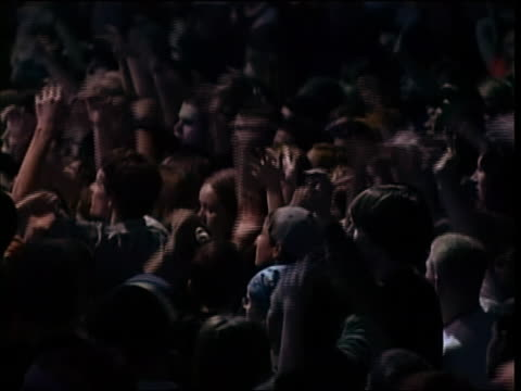wide shot people at concert waving arms in the air / russia - braccio umano video stock e b–roll