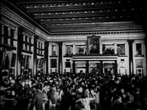 B/W 1920 wide shot people dancing at graduation dance in large ballroom / West Point, NY / documentary