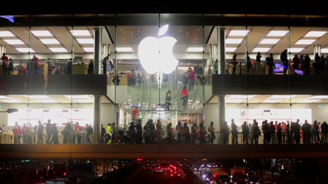 Wide Shot people gather in the Apple store on December 19 2013 in Hong Kong China
