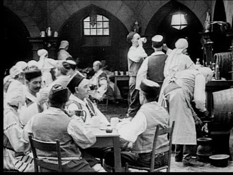 1916 wide shot people in tavern all getting up and running out at once - pub stock videos & royalty-free footage