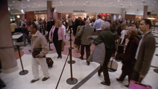 Wide shot people moving through security line / Hartsfield Airport, Atlanta