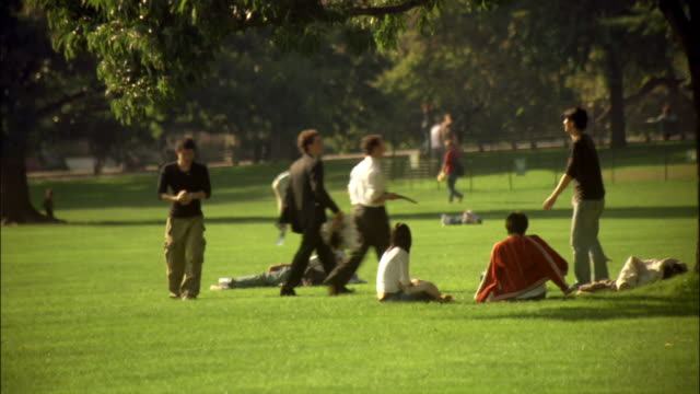 wide shot people playing hacky sack in central park/ new york city - bean bag stock videos & royalty-free footage