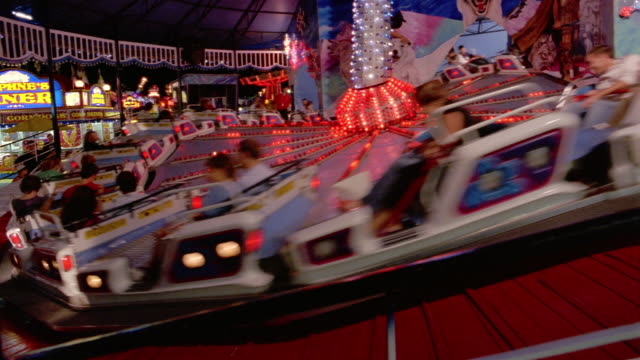 wide shot people riding backwards on carnival ride at canadian national exhibition at night / toronto - kelly mason videos stock-videos und b-roll-filmmaterial