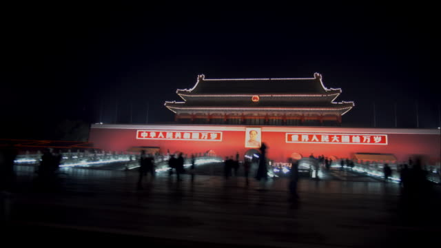 wide shot people walking and cycling past gate of heavenly peace in tiananmen square/ beijing, china - tiananmen gate of heavenly peace stock videos & royalty-free footage