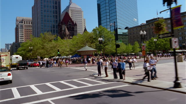 Wide shot point of view driving past Copley Square / Boston