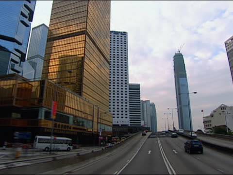 2002 wide shot point of view driving through city/ hong kong - bank of china tornet hongkong bildbanksvideor och videomaterial från bakom kulisserna