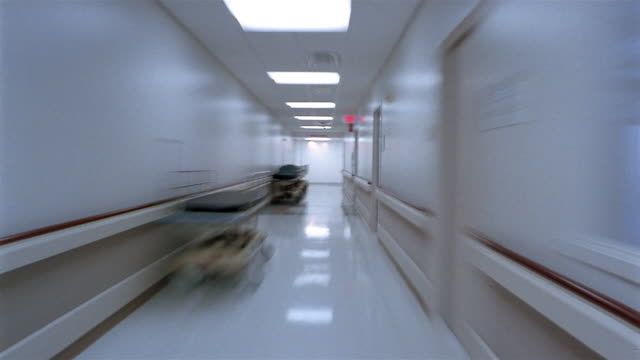 Wide shot point of view moving through hallways of hospital / Houston, Texas