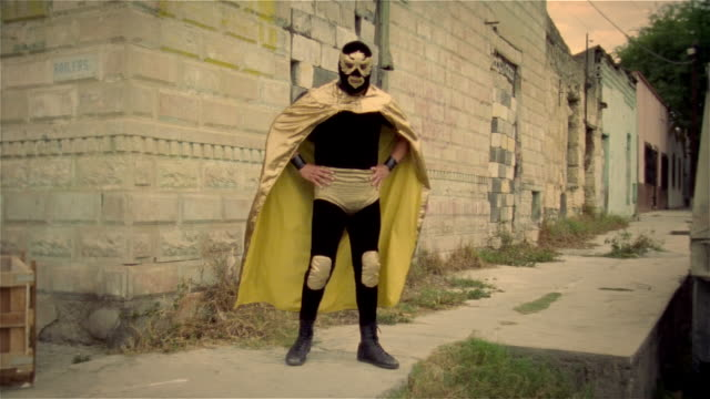 """wide shot portrait luchador """"pegaso"""" posing in front of wall/ monterrey, mexico - 2006 stock videos & royalty-free footage"""