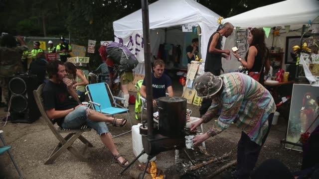 wide shot, protester camp. protesters gather outside a drill site operated by cuadrilla resources ltd on august 19, 2013 in balcombe, west sussex.... - west sussex stock videos & royalty-free footage