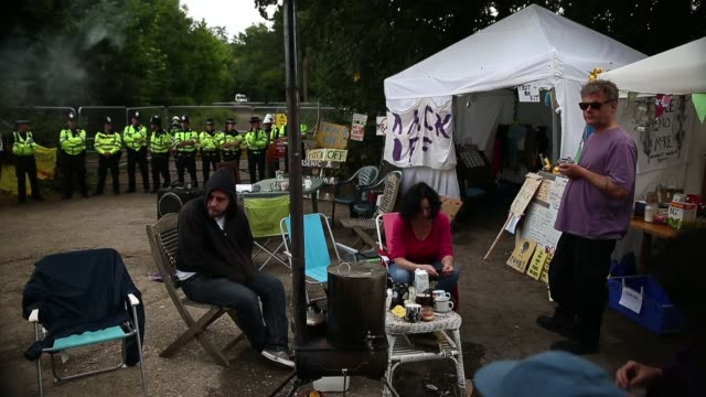 wide shot, protestors outside of site entrance. protesters gather outside a drill site operated by cuadrilla resources ltd on august 19, 2013 in... - west sussex stock videos & royalty-free footage