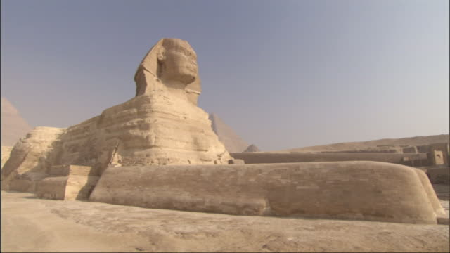 Wide Shot, push-in - The Sphinx stands majestically in the desert of Egypt / Egypt