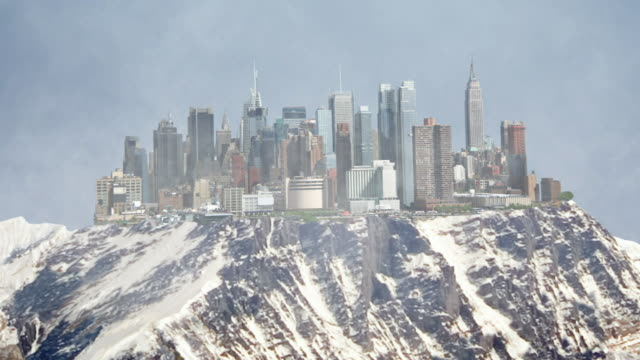Wide Shot push-out - A glacier forms over the crumbled ruins of New York City in a computer-generated animation. / New York City, New York, USA