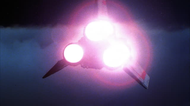 wide shot rear view of three-winged spacecraft with glowing boosters flying through atmosphere toward space - spaceship stock videos & royalty-free footage