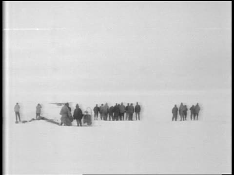 b/w 1929 wide shot rear view people waving cheering as airplane takes off from snowy plain - 1929 stock videos and b-roll footage