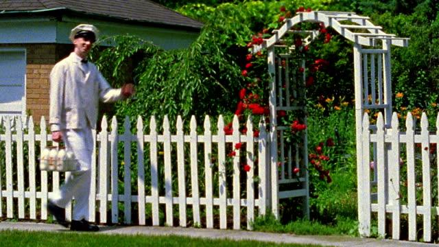 wide shot reenactment milkman walking on street and waving - milkman stock videos & royalty-free footage
