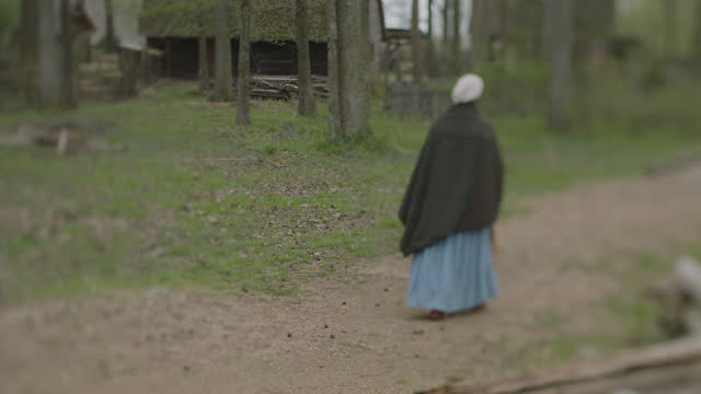 wide shot reenactment of a woman walking along the path during the 17th century. - 17th century stock videos & royalty-free footage