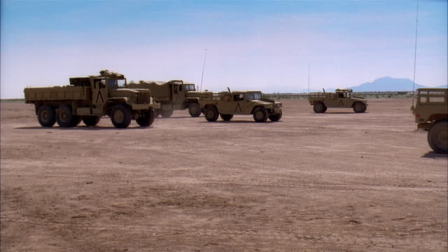 wide shot reenactment soldiers driving military land vehicles across desert battlefield/ mexico - mode of transport stock videos & royalty-free footage