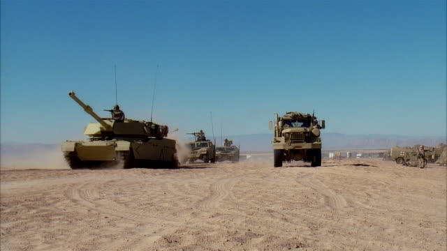 wide shot reenactment soldiers driving military land vehicles and arriving on desert battlefield/ mexico - remote location stock videos & royalty-free footage