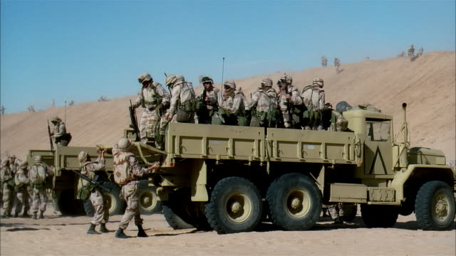 wide shot reenactment soldiers driving military land vehicles and arriving on desert battlefield/ mexico - us marine corps stock videos & royalty-free footage