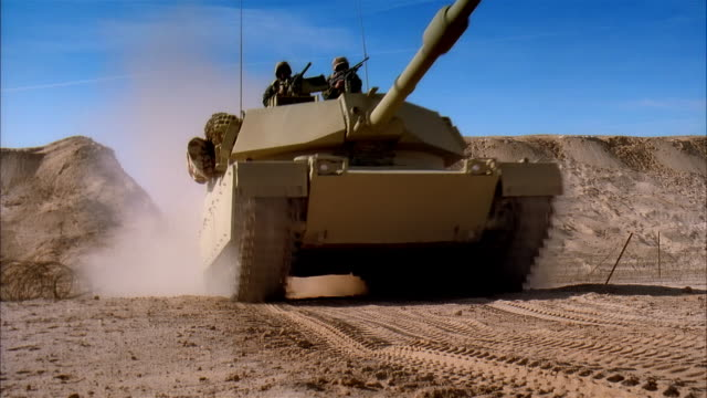 wide shot reenactment soldiers driving military land vehicles over dirt hill and walking toward desert battlefield/ mexico - marine stock-videos und b-roll-filmmaterial
