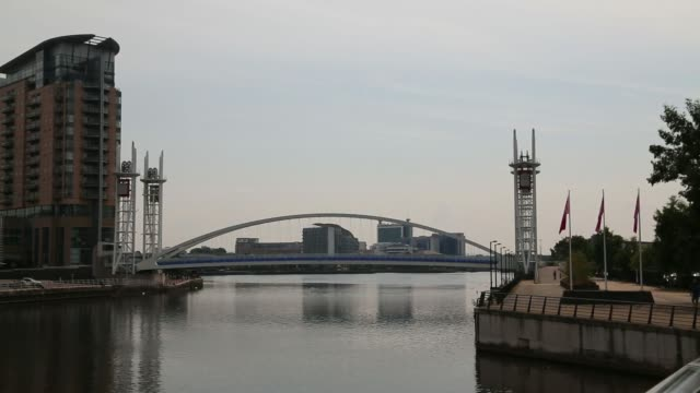 Wide shot residential properties around the Detroit Bridge waterfront area at Salford Quays Greater Manchester UK on Wednesday July 2 The Lowry...