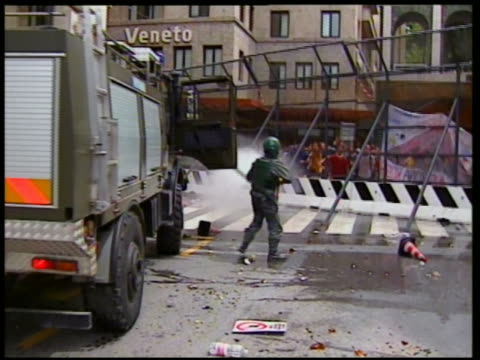 2001 wide shot riot policeman hopping out of truck / hosing down protesters / g8 summit / genoa italy - g8 stock-videos und b-roll-filmmaterial