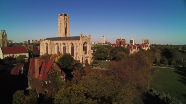 Wide shot rising above University of Chicago campus on bright autumn day