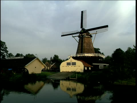 2000 Wide shot River flowing past windmill/ Utrecht, Netherlands