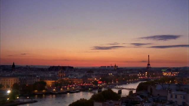 Wide shot River Seine and Eiffel Tower at sunset / Paris, France
