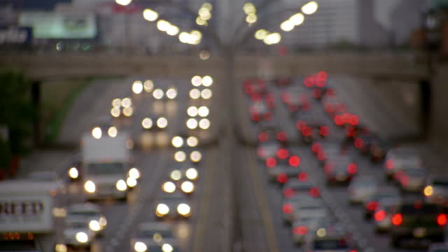 wide shot rush hour traffic on gardiner expressway and pedestrians on overpass at dusk / toronto - toronto stock videos & royalty-free footage