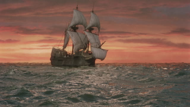 wide shot sailing ship on ocean at sunset / reenactment / plymouth adventure (1952) - pellegrino video stock e b–roll
