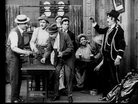 1910 b/w wide shot salesman arriving in tavern to gamble with other men  - dice stock videos & royalty-free footage