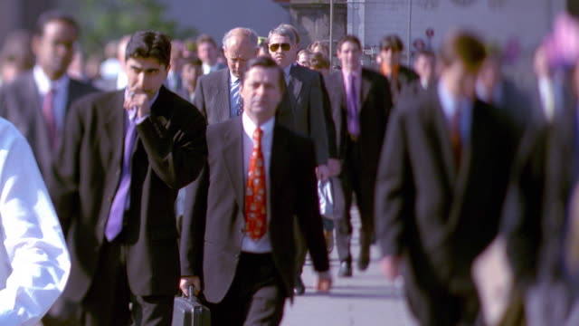 wide shot selective focus business crowds walking from tube station during rush hour / london - suit stock videos & royalty-free footage