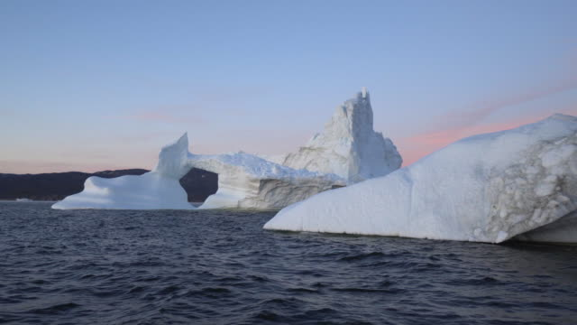 wide shot: serene view of mass of huge ice in disko bay - inlet stock videos & royalty-free footage