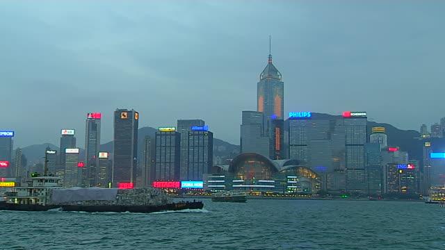 wide shot ship passing aberdeen harbour hong kong kwangtung china - aberdeen hong kong stock videos & royalty-free footage