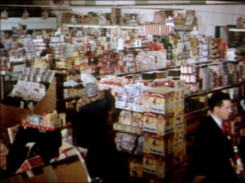 1951 wide shot shoppers and stockperson in supermarket / audio - consumerism stock videos and b-roll footage