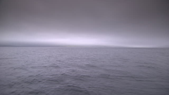 wide shot showing calm waters off the coast of county cork, ireland. - grey colour stock videos & royalty-free footage