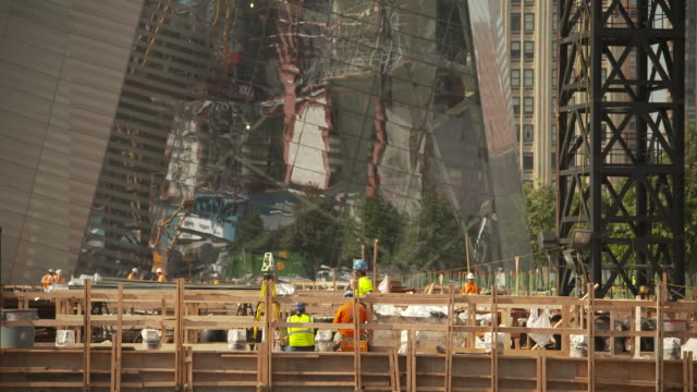 wide shot showing construction workers at the new world trade center site resting, summer 2011, manhattan, new york city, usa. - september 11 2001 attacks stock videos and b-roll footage